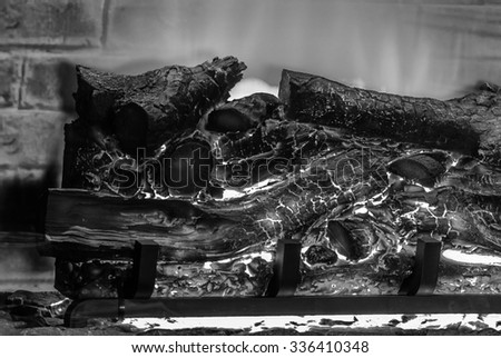 burning wood in Fireplace. Black and white