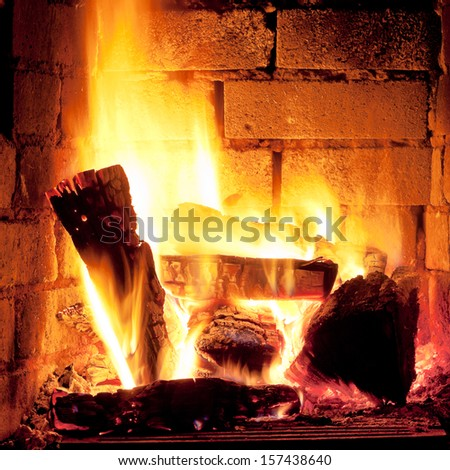 burning wood in fireplace in evening time - stock photo
