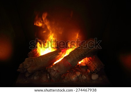 Burning wood in Indoor fireplace close-up - stock photo