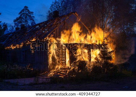 Burning wooden house.