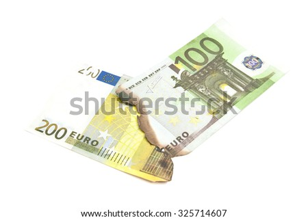 burnt bills of euro on white background closeup