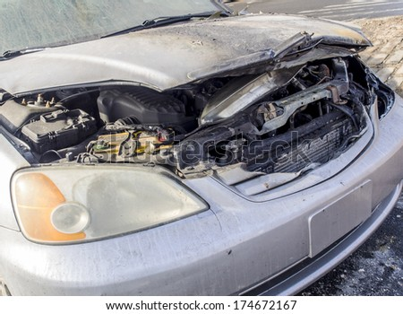 Burnt car with open hood