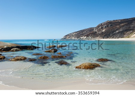 Burnt cliff coast at Torndirrup National Park, Albany, Western Australia, turquoise Southern Ocean at Salmon Beach, summer sunny blue sky, copy space. - stock photo