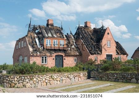 Burnt down house - stock photo