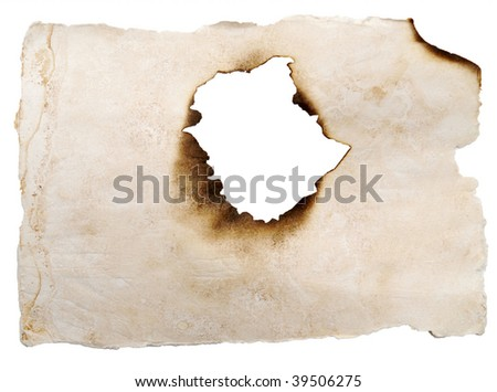 burnt hole in a paper isolated on white