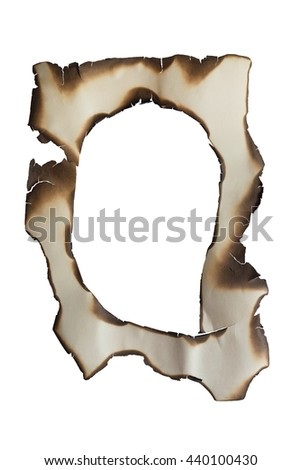 Burnt hole in a paper isolated on white background. Can be used like a frame. Empty copy space for text or images. - stock photo
