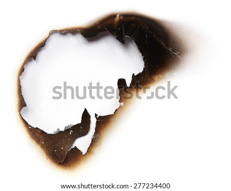 Burnt hole of white paper - stock photo
