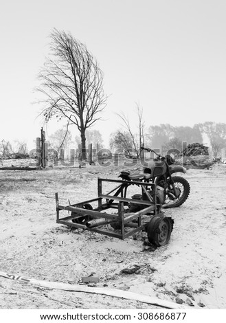 Burnt motorbike in a burnt village