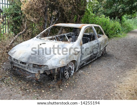 Burnt out Car Wreck on a country path
