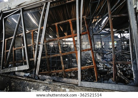 Burnt out property house after fire. - stock photo