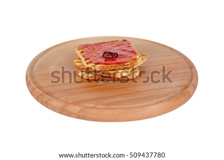Burnt toasted bread with jam on wooden table, isolated on white background.