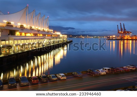 "Burrard Inlet Waterfront Morning, Vancouver. The Vancouver Trade and Convention Center also known as ""Canada Place"" on Burrard Inlet in the early morning. British Columbia, Canada.  - stock photo"