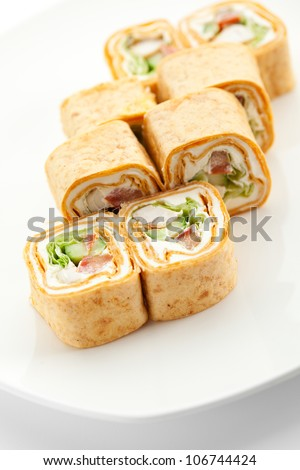 Burrito Maki Sushi - Roll made of Smoked Chicken Breast, Cream Cheese and Cucumber inside. Tortilla outside