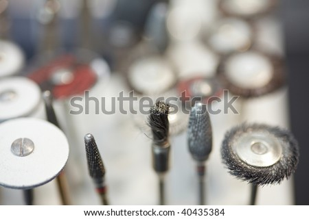 Burs and polishers and drills in a dental lab - stock photo