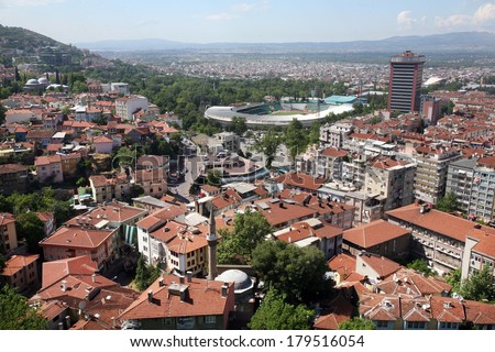 BURSA, TURKEY - MAY 19: View of Bursa City and Bursa Ataturk Stadium on May 19, 2010 in Bursa, Turkey. Bursa is the fourth most populous city in Turkey and was the second capital of the Ottoman State. - stock photo