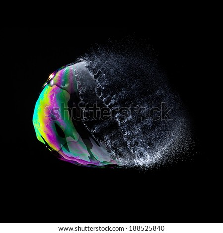 burst Soap Bubble in colorful colors on black background - stock photo