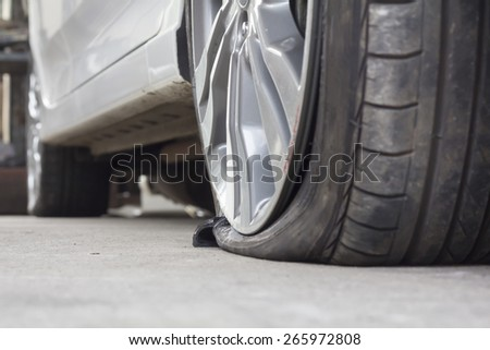 burst tire - stock photo