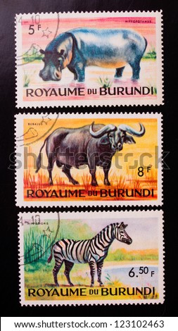 BURUNDI - CIRCA 1970: A stamp printed in Burundi shows three kinds of animals from the hot countries , circa 1970.