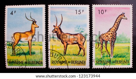 BURUNDI- CIRCA 1964: A stamp printed in Burundi shows three kinds of wild animals , circa 1964. - stock photo