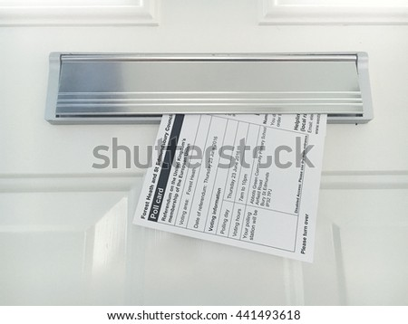 Bury Saint Edmunds, UK-June 23 2016: a polling card delivered to a letterbox on the day of the UK referendum vote - stock photo