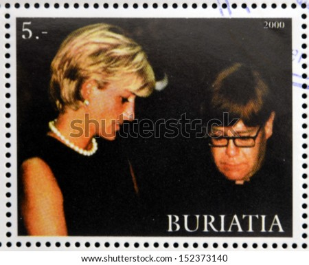 BURYATIA - CIRCA 2000: A stamp printed in Buryatia shows Diana of Gales and Elton John, circa 2000   - stock photo
