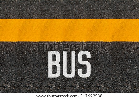 Bus and Yellow Line  Printed On The Road - stock photo