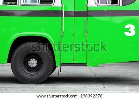 Bus, Autobus, School bus side view, wing with a wheel, Green bus. - stock photo