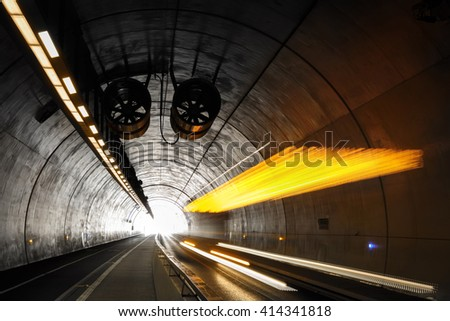 Bus driving in Tunnel de la Croix-Rousse, a tunnel for public transports, cyclist and pedestrians in Lyon, France. - stock photo