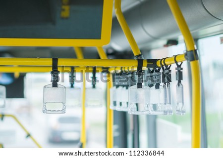 Bus handles for standing passengers - stock photo