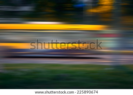 Bus in speed motion blur on city street at night - stock photo