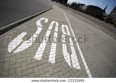 Bus Lane Sign – Big White Letters on the Road - stock photo