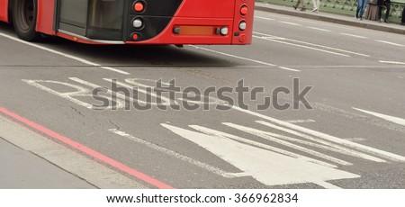 Bus lane sign on road, London, UK. - stock photo