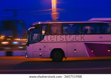 bus moves on city street at night - stock photo