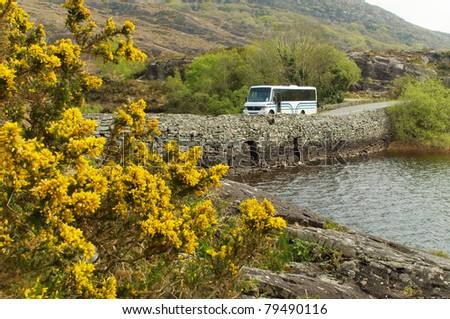 Bus on a bridge at Killarney, Ireland - stock photo