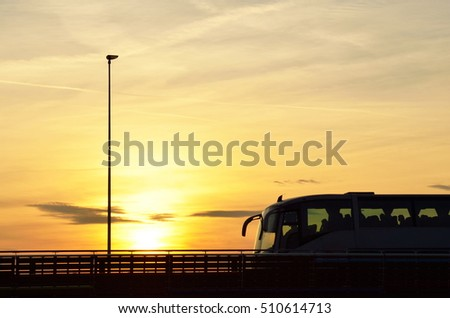 Bus over the bridge at sunset in Rimini, Italy