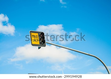 Bus Sign with traffic light against Sky Background - stock photo