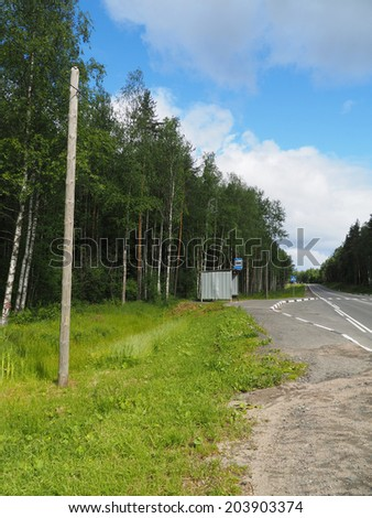 bus stop in the forest - stock photo