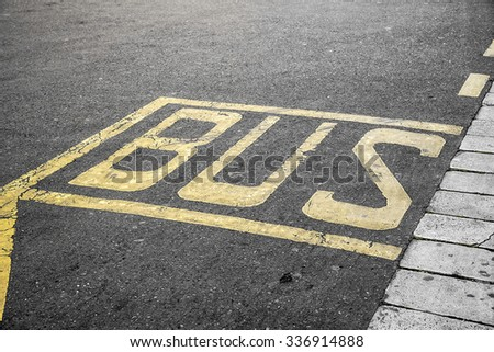 Bus stop sign painted on the road. - stock photo
