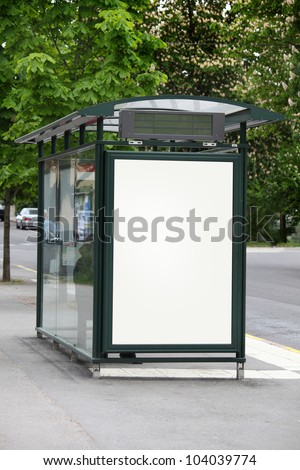 Bus stop with a blank billboard - stock photo