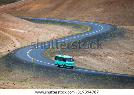 Bus with tourists on Ring road near Myvatn lake, Iceland
