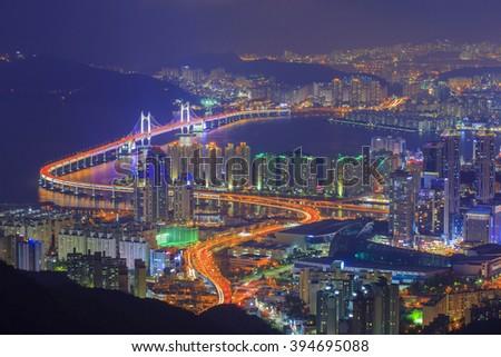 Busan,GwangAn Bridge and Haeundae in South Korea aerial view at night. - stock photo