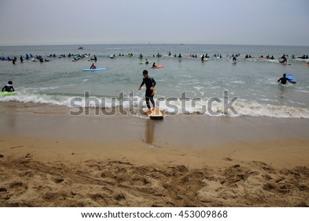 Busan, Korea - July 10, 2016: Songjeong beach. It is located near the Haeundae beach. It has become famous for surfing place because of its clean white sand and good waves in recent years