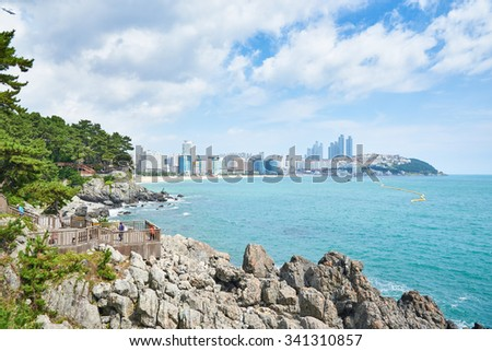 Busan, Korea - September 19, 2015: Haeundae beach is one of the most famous beaches in South Korea. And Dongbaek-seom is a small island near the Haeundae beach. Dongbaek means camellia tree.