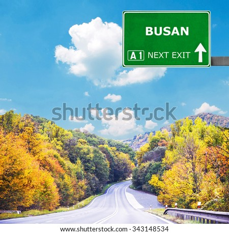 BUSAN road sign against clear blue sky - stock photo