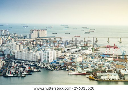 Busan, South Korea - February 26, 2015 : View of Busan port. Busan has one of the world's largest ports can handle more than 13.2 million shipping containers per year. - stock photo