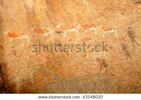 Bushmen rock painting of human figures and antelopes, Brandberg archaeological site, Namibia, southern Africa - stock photo