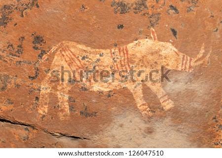 Bushmen (san) rock painting depicting a rhinoceros, Drakensberg mountains, South Africa - stock photo