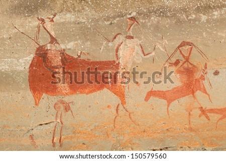 Bushmen (san) rock painting of human figures and antelopes, Drakensberg mountains, South Africa  - stock photo