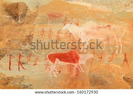 Bushmen (san) rock painting of humans and antelopes, Drakensberg mountains, South Africa  - stock photo