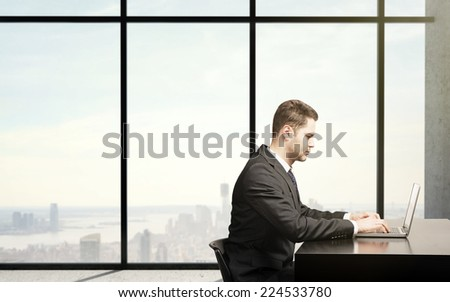 busienssman sitting in office with  laptop, close up - stock photo